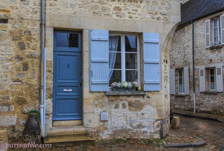 senlis cottage blue door shutters flowers cobbled street